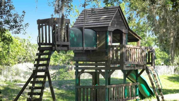 whether you build a custom swing set, fort or treehouse (this one is a bit of all 3) or buy one to assemble, make sure you plan for several weekends to install a swing set