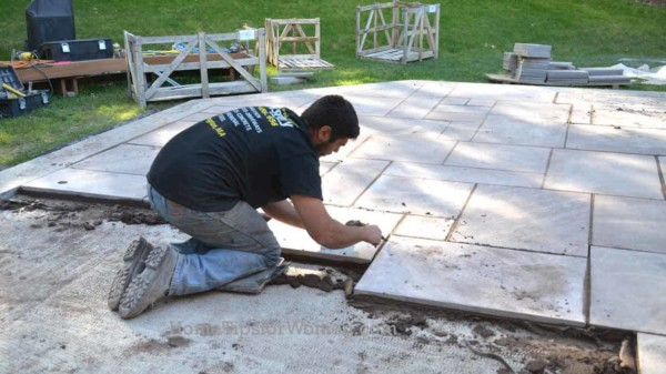 whether you're building a patio or deck, it's a lot more work than you realize so you might want to hire a pro