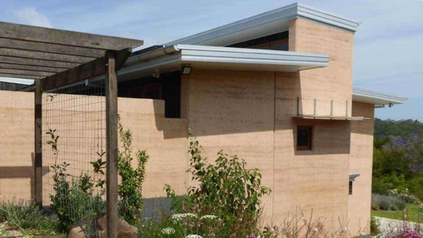 the exterior of a rammed earth house built by RammedEarthConstructions.com in Australia