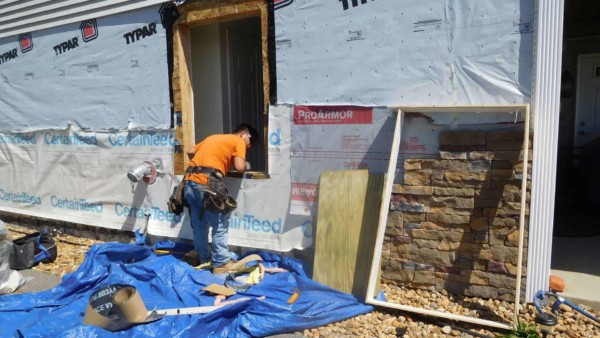 Contractors repairing flooded exterior walls & did they have flood insurance?