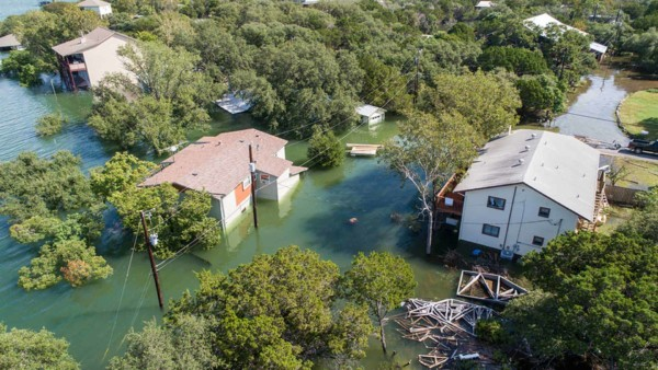 Flooded houses surrounded by water although we don't know what the flood risk maps predicted