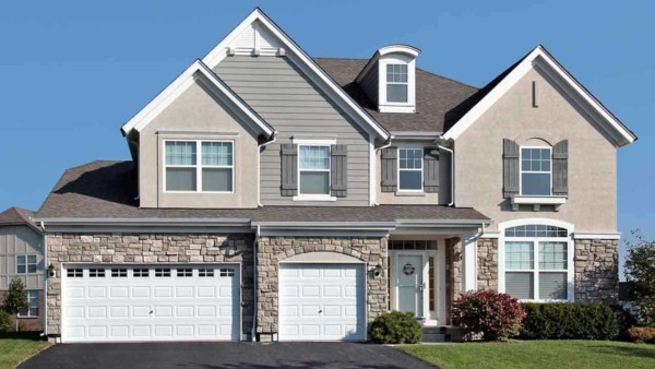 you can use more than one house siding like this house with stone, stucco and clapboard ... but make sure the overall look isn't too busy or cluttered