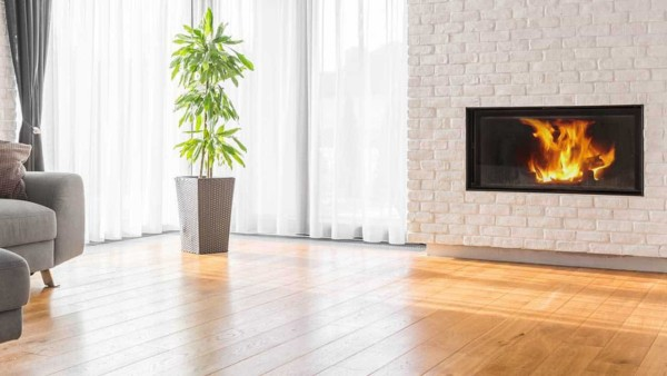 sometimes you have to work with a fireplace you already have but don't like; old red brick fireplaces can be painted with white shown here, the most popular color for a painted fireplace