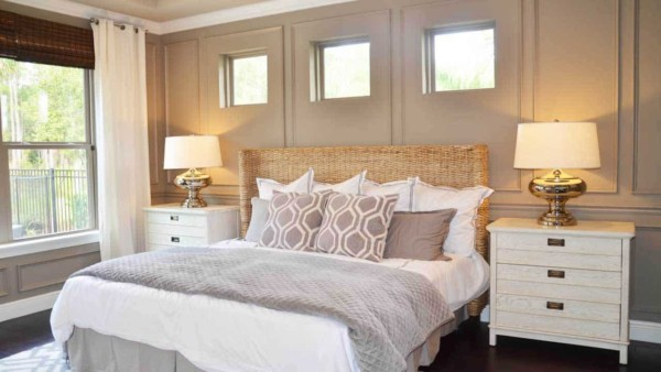 Master bedroom with windows over the bed, painted in beige matte paint finish