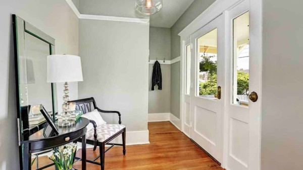 in order to clear the clutter, everything needs a home so start with your entryway & make sure there's an easy place to hang jackets like the hooks in this hidden nook