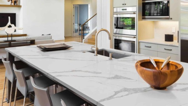 Calcatta marble is among the most luxurious countertop materials with it's light veins that flow naturally ...