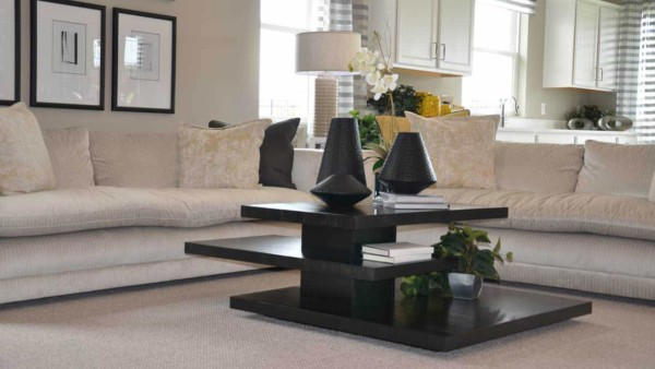 it's easy to clear the clutter in an open floor plan with closed storage and open shelving like this coffee table provides