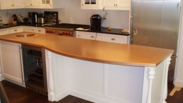 one of the most exciting countertop materials is copper, either shiny (shown here) or hammered