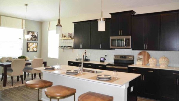 it's more important to clear the clutter when you have an open floor plan & can see several rooms at once, like this kitchen & eating nook (living room behind)