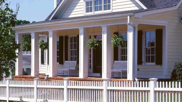 one of the newer house siding choices is fiber cement, like this farmhouse with Hardii plank siding; it looks like wood with minimal maintenance required which is a big plus for time starved homeowners