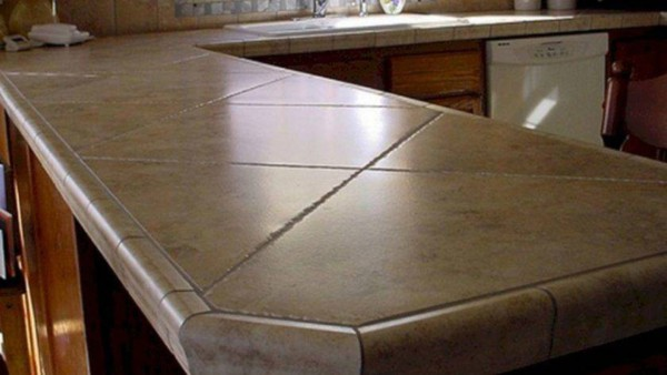 Tile countertop installed diagonally ... used to be an upscale countertop material