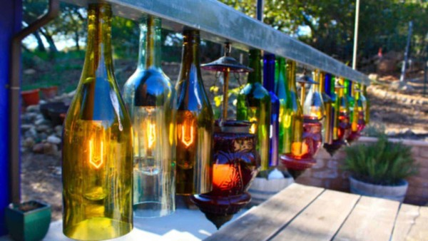 outdoor home decor can include a DIY project building these wine bottle lights