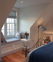 attics can offer more living space like this bedroom, homeowner glossary