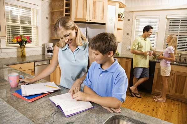 busy parents need kids to do homework where it's easy to help them out