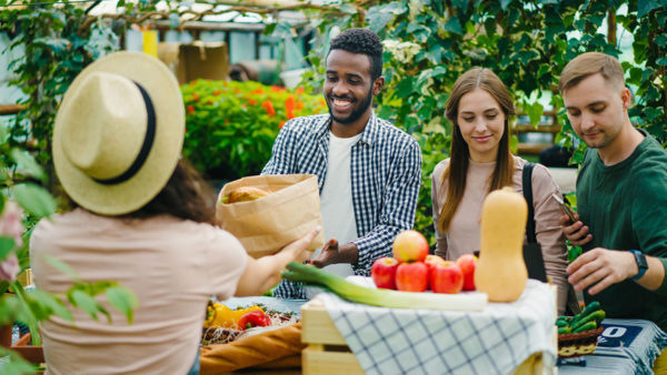 young people shopping at farmer's market, won't be as easy after they're home buying journey succeeds
