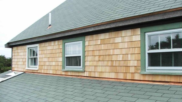 there are many layers hidden behind your home's exterior, each feature playing a role like flashing that guides water past seams where the siding & roofing meet in this photo