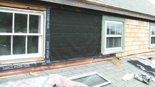 Wood shingle siding & copper flashing being replaced on a house in Nantucket