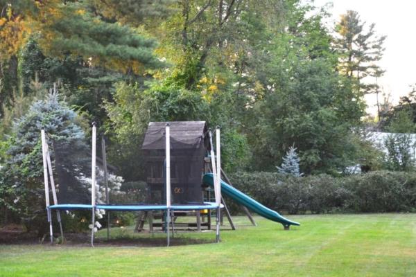 backyard fun on a trampoline is a favorite of most kids ...