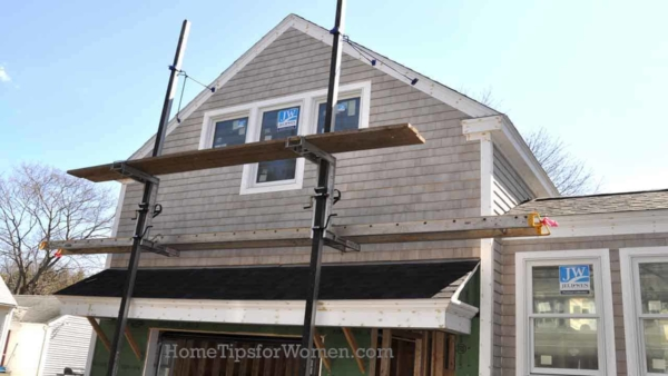 building a garage addition like the one shown here in Newburyport MA, is more complicated when you attach the garage to the house, as this enclosed walkway was