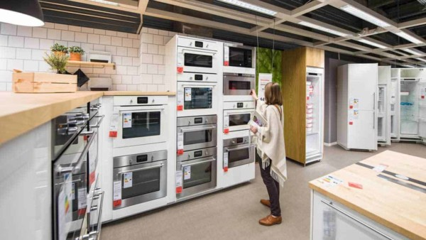 before this woman buys her kitchen appliances, she should check for appliance recalls