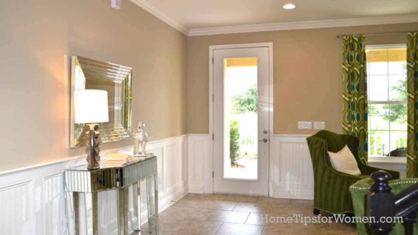 entryway to house with crown molding, chair rail & paneling & walls matte paint finish