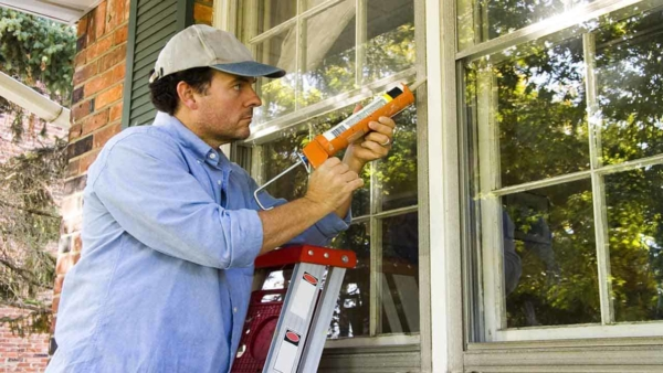 it's easier to deal with exterior home maintenance if you do a little every year, like caulking windows to keep your heating & cooling costs under control