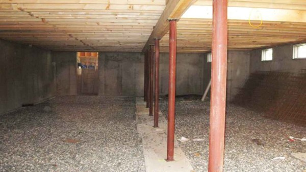 lally colums are filled with concrete to support the weight of a load bearing wall