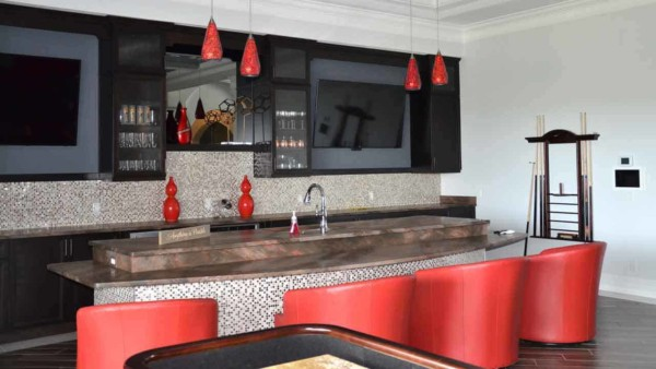 you don't have to go anywhere for a pool table & bar at this custom family vacation home