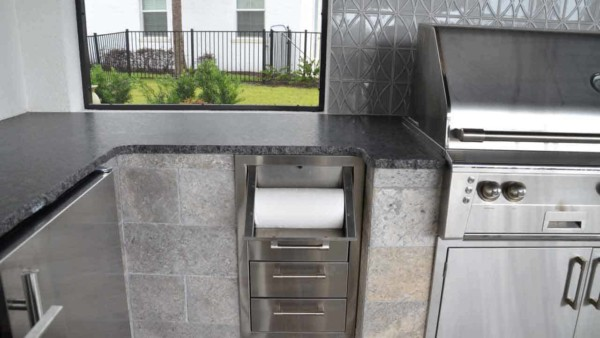 love the paper towel holder in the outdoor kitchen