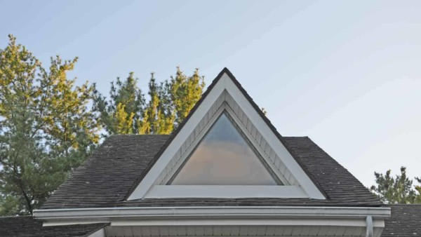custom windows often match the shape of the roof like this triangular window