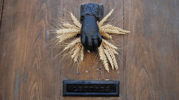 why not have a hand welcome your guests like this front door handle