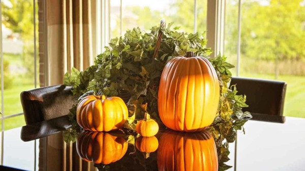 we love our Thanksgiving traditions & decorating with a few pumpkins is relatively easy & inexpensive
