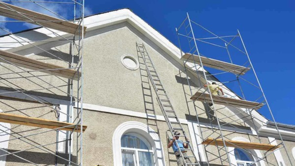 one of the toughest home maintenance projects is an exterior paint job where ladders aren't enough and you need scaffolding