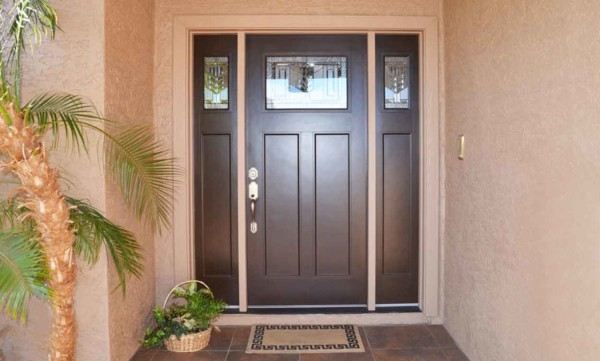 an exterior door is wrapped with trim (also called casing) to hide the gap between the door and structural wall