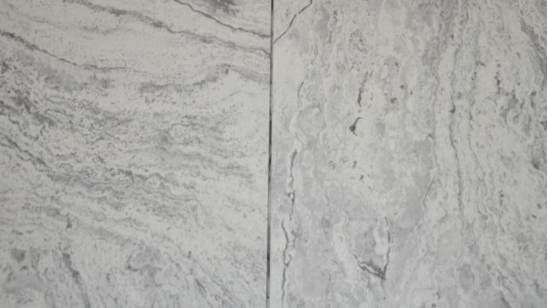 far away, this tile might look gray, but a closer looks shows that there are several shades of grey in multiple hues