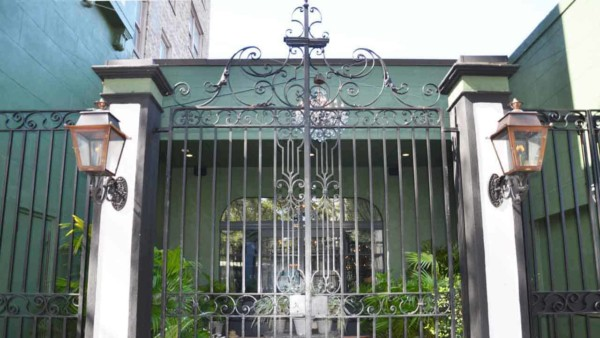 only in New Orleans would someone think about decorating with lanterns when you've got such a beautiful fence