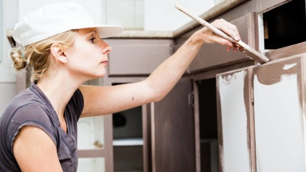 homeowner painting cabinets