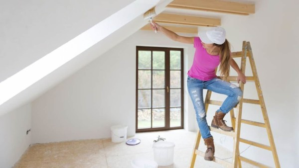 homeowner painting cathedral ceiling