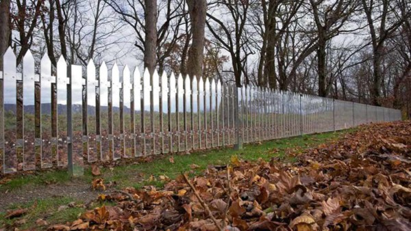 imagine a fence that tells the story of a changing landscape like this mirrored picket fence