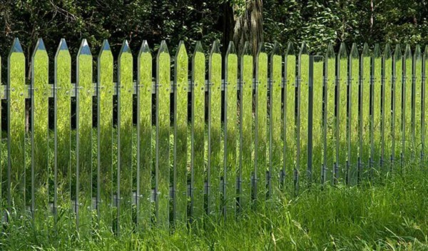 your picket fence doesn't have to be traditional wood & white; it can be extraordinary like this mirrored picket fence