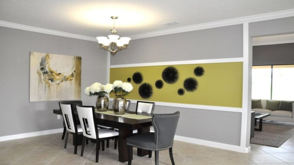 this dining room has a color trend of green and grey