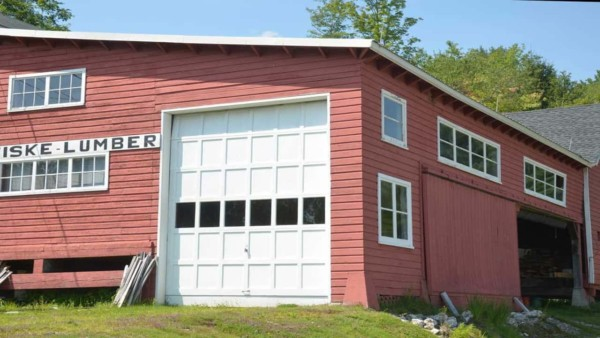 this red barn is more modern, with a large white garage door