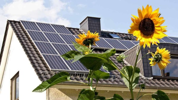 energy efficient homes focus on using less energy & some generate energy with solar panels like this house has