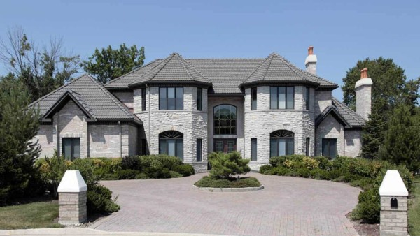 custom homes like this one have more complicated exteriors (interiors too) and lovely landscaping like this brick driveway ... and are found in communities that have considerable wealth, like Newburyport Massachuetts