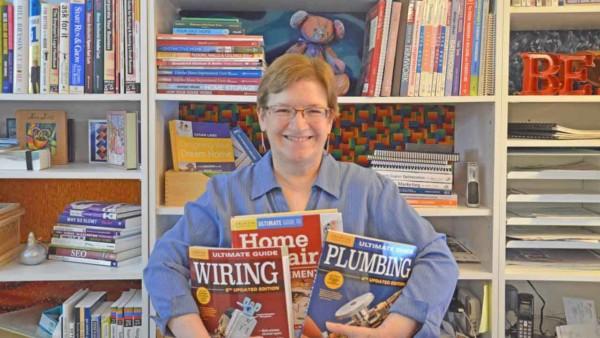 Tina hugging homeowner improvement books