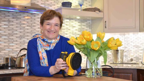 Tina Gleisner, home expert and founder of Home Tips for Women ... in the kitchen with flowers & palm sander