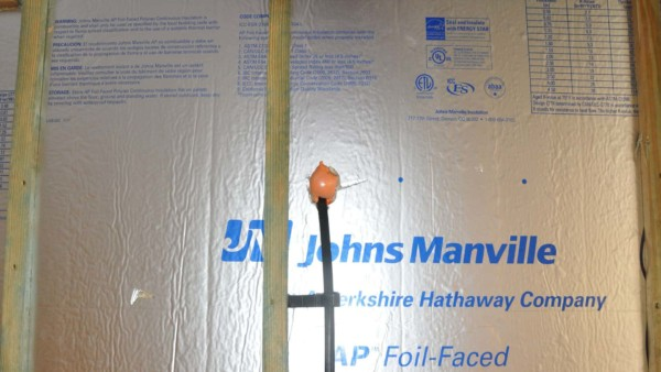 insulation panels with radiant barrier to reduce heat infiltration through these wall insulation panels