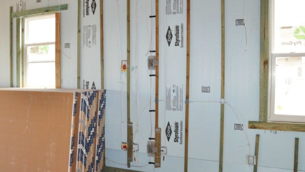 rigid styrofoam wall insulation panels installed with furring strips for drywall