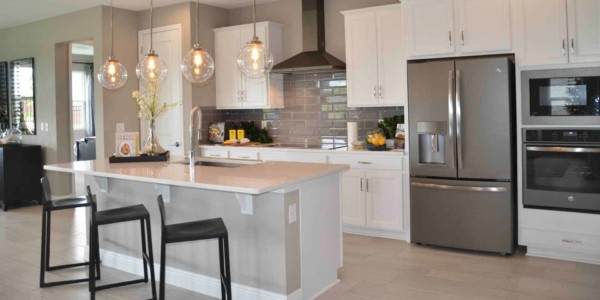 model home's kitchen in white & stainless
