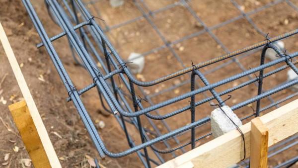 rebar framing the perimeter of a house
